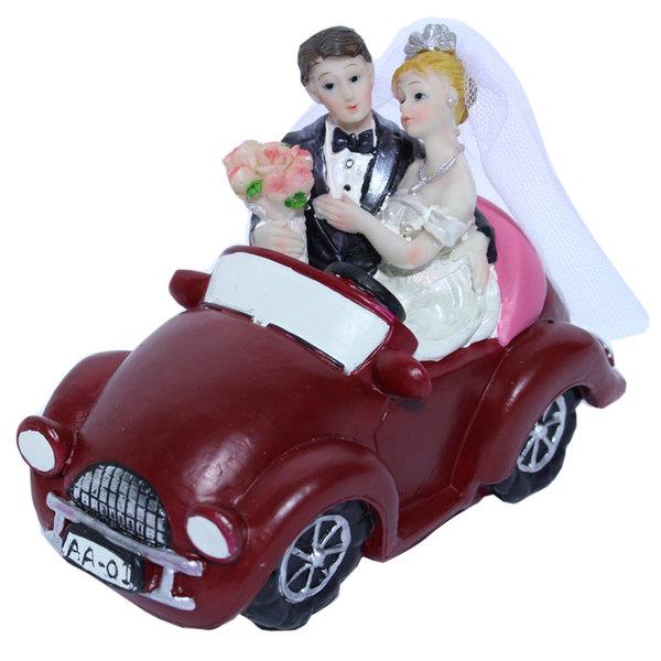 Taarttopper bruidspaar in auto