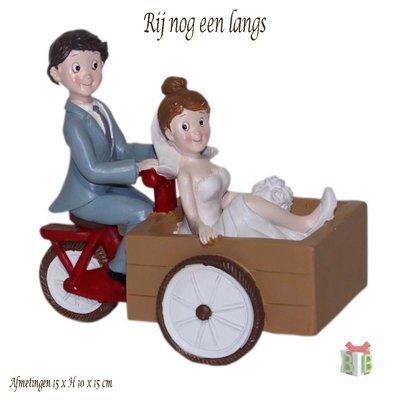 Taarttopper voor bruidstaart fietsend bruidspaar